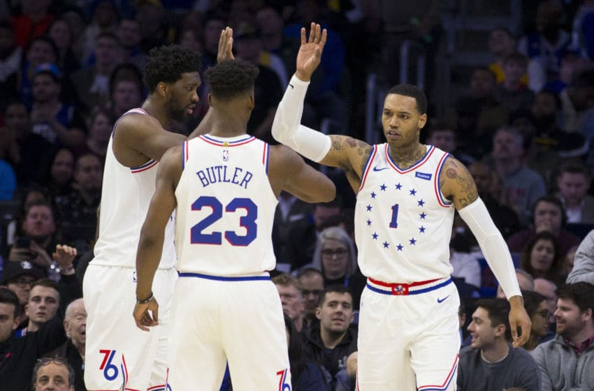 PHILADELPHIA, PA - FEBRUARY 10: Joel Embiid #21, Jimmy Butler #23, and Mike Scott #1 of the Philadelphia 76ers react against the Los Angeles Lakers at the Wells Fargo Center on February 10, 2019 in Philadelphia, Pennsylvania. The 76ers defeated the Lakers 143-120. NOTE TO USER: User expressly acknowledges and agrees that, by downloading and or using this photograph, User is consenting to the terms and conditions of the Getty Images License Agreement.(Photo by Mitchell Leff/Getty Images)