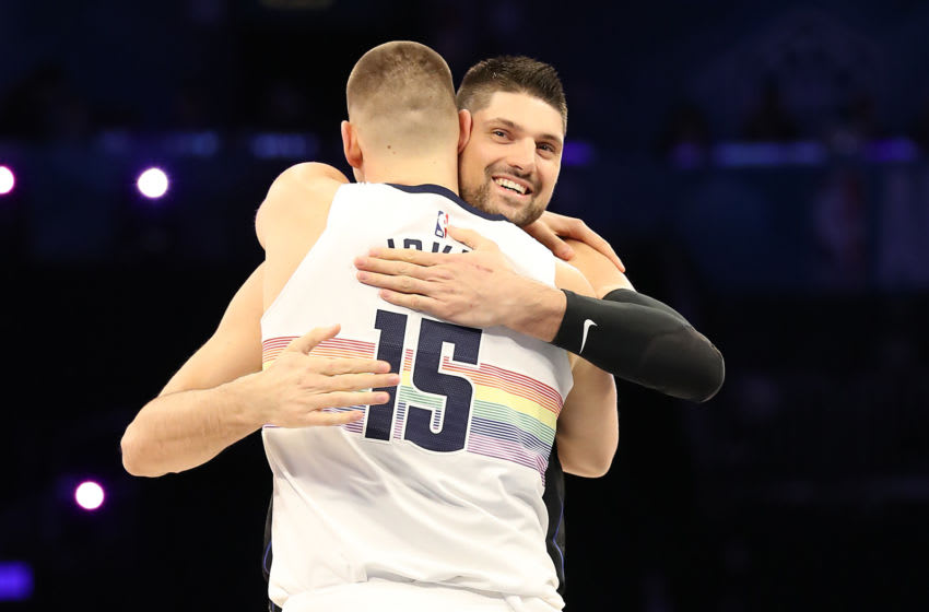 CHARLOTTE, NORTH CAROLINA - FEBRUARY 16: Nikola Jokic #15 of the Denver Nuggets and Nikola Vučević #9 of the Orlando Magic show camaraderie during the Taco Bell Skills Challenge as part of the 2019 NBA All-Star Weekend at Spectrum Center on February 16, 2019 in Charlotte, North Carolina. (Photo by Streeter Lecka/Getty Images)