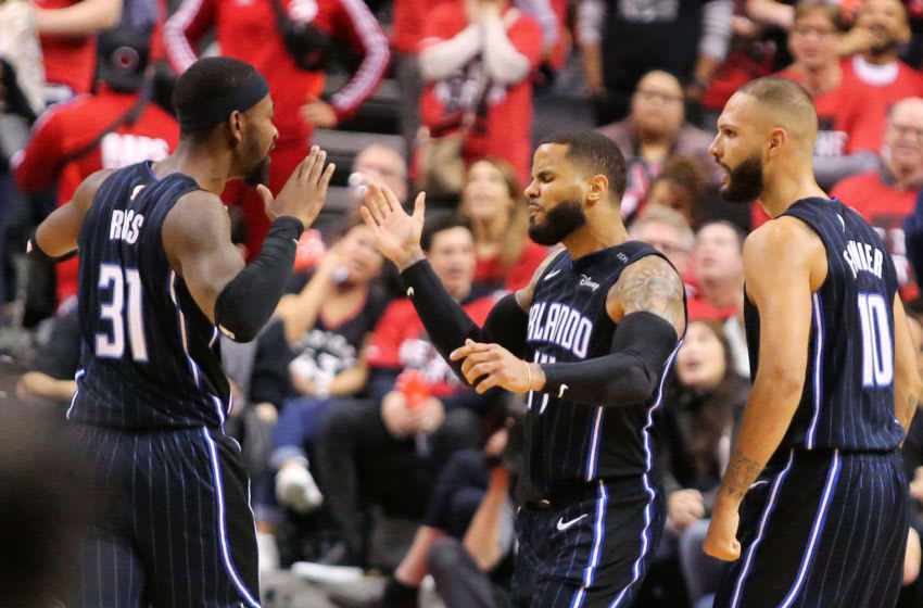 The Orlando Magic's D.J. Augustin, middle, is congratulated by teammates Terrence Ross (31) and Evan Fournier (10) after Augustin hit the game-winning basket in the final seconds against the Toronto Raptors during Game 1 in the first round of the NBA Playoffs at Scotiabank Arena in Toronto on Saturday, April 13, 2019. The Magic won, 104-101. (Joe Burbank/Orlando Sentinel/TNS via Getty Images)