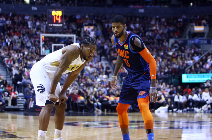 TORONTO, ON - MARCH 22: Kawhi Leonard #2 of the Toronto Raptors and Paul George #13 of the Oklahoma City Thunder prepare for play to resume during the second half of an NBA game at Scotiabank Arena on March 22, 2019 in Toronto, Canada. NOTE TO USER: User expressly acknowledges and agrees that, by downloading and or using this photograph, User is consenting to the terms and conditions of the Getty Images License Agreement. (Photo by Vaughn Ridley/Getty Images)