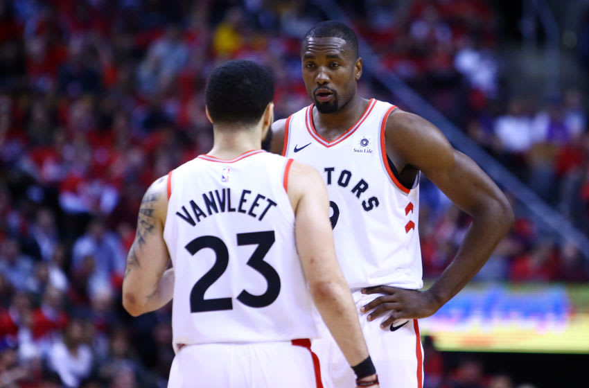 TORONTO, ON - APRIL 23: Fred VanVleet #23 speaks with Serge Ibaka #9 of the Toronto Raptors during Game Five of the first round of the 2019 NBA Playoffs against the Orlando Magic at Scotiabank Arena on April 23, 2019 in Toronto, Canada. NOTE TO USER: User expressly acknowledges and agrees that, by downloading and or using this photograph, User is consenting to the terms and conditions of the Getty Images License Agreement. (Photo by Vaughn Ridley/Getty Images)