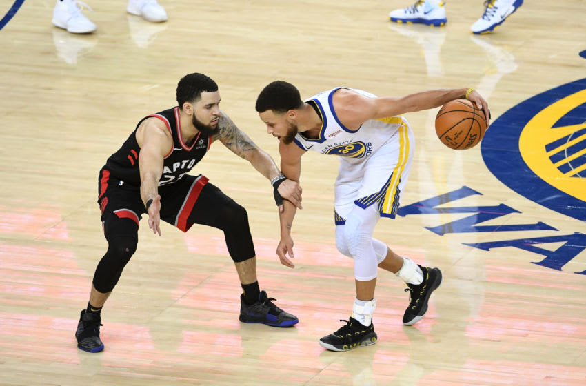 OAKLAND, CA - JUNE 5: Stephen Curry #30 of the Golden State Warriors handles the ball against Fred VanVleet #23 of the Toronto Raptors during Game Three of the NBA Finals on June 5, 2019 at ORACLE Arena in Oakland, California. NOTE TO USER: User expressly acknowledges and agrees that, by downloading and/or using this photograph, user is consenting to the terms and conditions of Getty Images License Agreement. Mandatory Copyright Notice: Copyright 2019 NBAE (Photo by Noah Graham/NBAE via Getty Images)