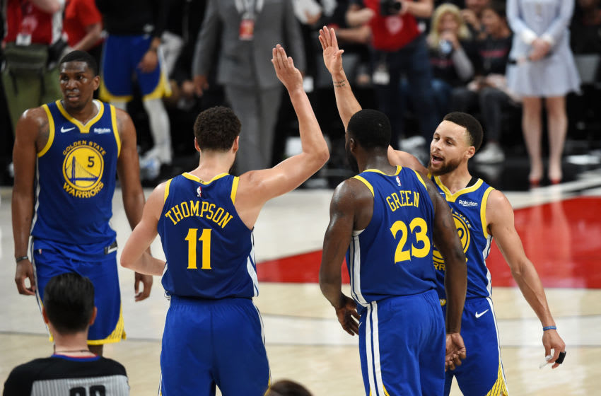 PORTLAND, OREGON - MAY 18: Stephen Curry #30 of the Golden State Warriors high fives teammates during the second half against the Portland Trail Blazers in game three of the NBA Western Conference Finals at Moda Center on May 18, 2019 in Portland, Oregon. NOTE TO USER: User expressly acknowledges and agrees that, by downloading and or using this photograph, User is consenting to the terms and conditions of the Getty Images License Agreement. (Photo by Steve Dykes/Getty Images)