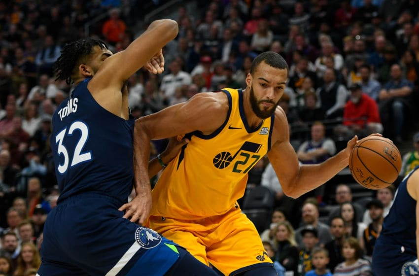 SALT LAKE CITY, UT - NOVEMBER 18: Rudy Gobert #27 of the Utah Jazz attempts to drive around Karl-Anthony Towns #32 of the Minnesota Timberwolves during a game at Vivint Smart Home Arena on November 18, 2019 in Salt Lake City, Utah. NOTE TO USER: User expressly acknowledges and agrees that, by downloading and/or using this photograph, user is consenting to the terms and conditions of the Getty Images License Agreement. (Photo by Alex Goodlett/Getty Images)