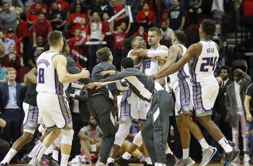 HOUSTON, TX - DECEMBER 09: Nemanja Bjelica #88 of the Sacramento Kings is congratulated by teammates after making a game-winning, three-point shot against the Houston Rockets at Toyota Center on December 9, 2019 in Houston, Texas. NOTE TO USER: User expressly acknowledges and agrees that, by downloading and or using this photograph, User is consenting to the terms and conditions of the Getty Images License Agreement. (Photo by Tim Warner/Getty Images)