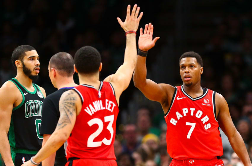 BOSTON, MA - DECEMBER 28: Kyle Lowry #7 high fives Fred VanVleet #23 of the Toronto Raptors during a game against the Boston Celtics at TD Garden on December 28, 2019 in Boston, Massachusetts. NOTE TO USER: User expressly acknowledges and agrees that, by downloading and or using this photograph, User is consenting to the terms and conditions of the Getty Images License Agreement. (Photo by Adam Glanzman/Getty Images)