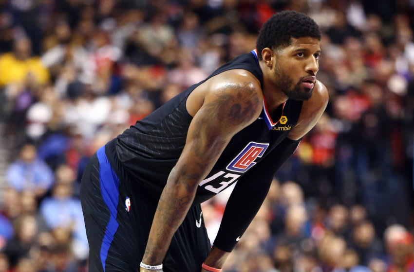 TORONTO, ON - DECEMBER 11: Paul George #13 of the Los Angeles Clippers looks on during the second half of an NBA game against the Toronto Raptors at Scotiabank Arena on December 11, 2019 in Toronto, Canada. NOTE TO USER: User expressly acknowledges and agrees that, by downloading and or using this photograph, User is consenting to the terms and conditions of the Getty Images License Agreement. (Photo by Vaughn Ridley/Getty Images)