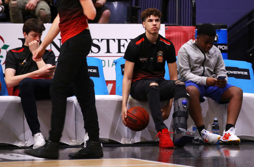 WOLLONGONG, AUSTRALIA - DECEMBER 16: Lamelo Ball of the Hawks is seen in a compression boot as he watches on from the bench during the warm-up before the round 11 NBL match between the Illawarra Hawks and Melbourne United at WIN Entertainment Centre on December 16, 2019 in Wollongong, Australia. (Photo by Mark Kolbe/Getty Images)