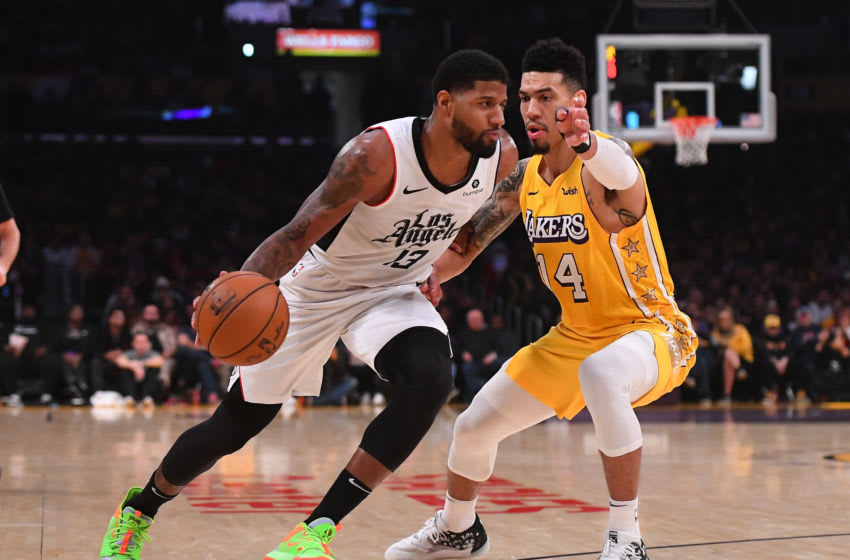 LOS ANGELES, CA - DECEMBER 25: Danny Green #14 of the Los Angeles Lakers guards Paul George #13 of the Los Angeles Clippers as he drives to the basket in the game at Staples Center on December 25, 2019 in Los Angeles, California. NOTE TO USER: User expressly acknowledges and agrees that, by downloading and/or using this Photograph, user is consenting to the terms and conditions of the Getty Images License Agreement. (Photo by Jayne Kamin-Oncea/Getty Images)