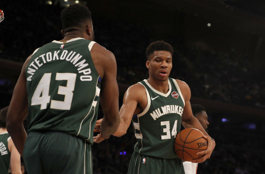 NEW YORK, NEW YORK - DECEMBER 21: (NEW YORK DALIES OUT) Giannis Antetokounmpo #34 and Thanasis Antetokounmpo #43 of the Milwaukee Bucks in action against the New York Knicks at Madison Square Garden on December 21, 2019 in New York City. The Bucks defeated the Knicks 123-102. NOTE TO USER: User expressly acknowledges and agrees that, by downloading and or using this photograph, user is consenting to the terms and conditions of the Getty Images License Agreement. (Photo by Jim McIsaac/Getty Images)