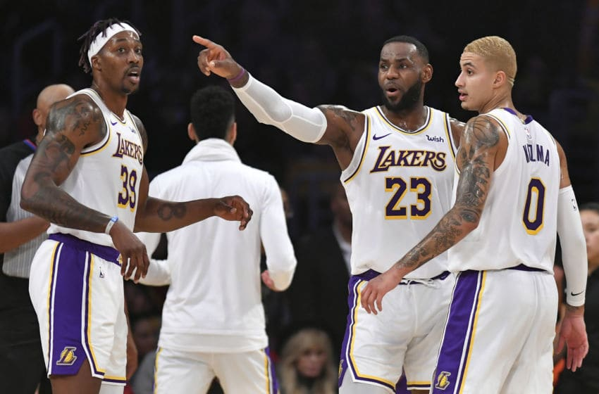 LOS ANGELES, CA - JANUARY 01: Dwight Howard #39, Lakers LeBron James and Kyle Kuzma #0 of the Los Angeles Lakers play the Phoenix Suns at Staples Center on January 1, 2020 in Los Angeles, California. NOTE TO USER: User expressly acknowledges and agrees that, by downloading and/or using this photograph, user is consenting to the terms and conditions of the Getty Images License Agreement. (Photo by John McCoy/Getty Images)