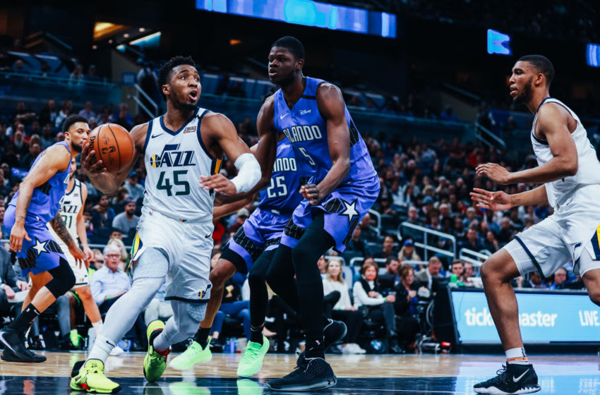 ORLANDO, FLORIDA - JANUARY 04: Donovan Mitchell #45 of the Utah Jazz charges to the basket past Mo Bamba #5 of the Orlando Magic in the third quarter at Amway Center on January 04, 2020 in Orlando, Florida. NOTE TO USER: User expressly acknowledges and agrees that, by downloading and/or using this photograph, user is consenting to the terms and conditions of the Getty Images License Agreement. (Photo by Harry Aaron/Getty Images)