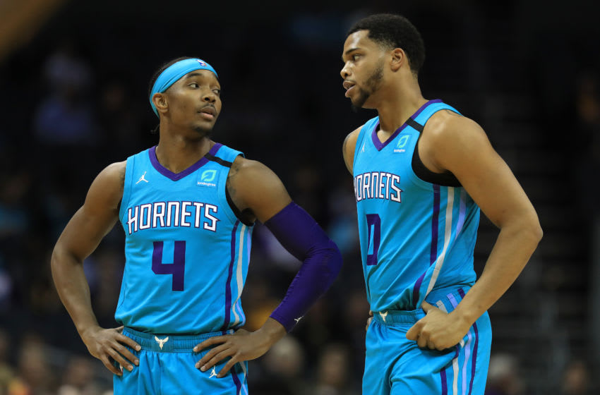 CHARLOTTE, NORTH CAROLINA - JANUARY 06: Devonte' Graham #4 talks to teammate Miles Bridges #0 of the Charlotte Hornets during their game against the Indiana Pacers at Spectrum Center on January 06, 2020 in Charlotte, North Carolina. NOTE TO USER: User expressly acknowledges and agrees that, by downloading and or using this photograph, User is consenting to the terms and conditions of the Getty Images License Agreement. (Photo by Streeter Lecka/Getty Images)