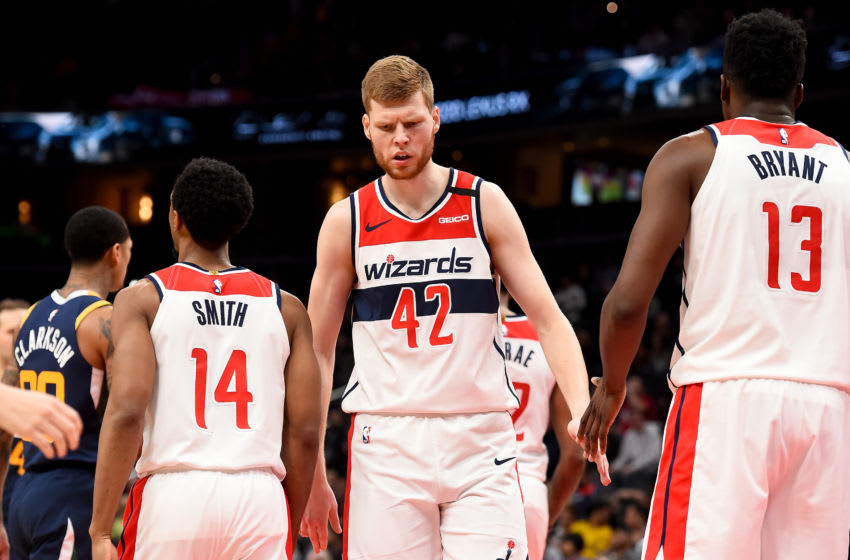 WASHINGTON, DC - JANUARY 12: Davis Bertans #42 of the Washington Wizards celebrates with Ish Smith #14 and Thomas Bryant #13 after a play against the Utah Jazz during the game at Capital One Arena on January 12, 2020 in Washington, DC. NOTE TO USER: User expressly acknowledges and agrees that, by downloading and or using this photograph, User is consenting to the terms and conditions of the Getty Images License Agreement. (Photo by Will Newton/Getty Images)