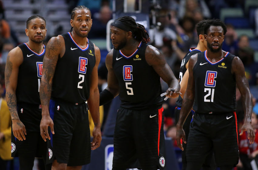 NEW ORLEANS, LOUISIANA - JANUARY 18: Kawhi Leonard #2 of the LA Clippers, Montrezl Harrell #5, Landry Shamet #20 and Patrick Beverley #21 talk during a game against the New Orleans Pelicans at the Smoothie King Center on January 18, 2020 in New Orleans, Louisiana. NOTE TO USER: User expressly acknowledges and agrees that, by downloading and or using this Photograph, user is consenting to the terms and conditions of the Getty Images License Agreement. (Photo by Jonathan Bachman/Getty Images)