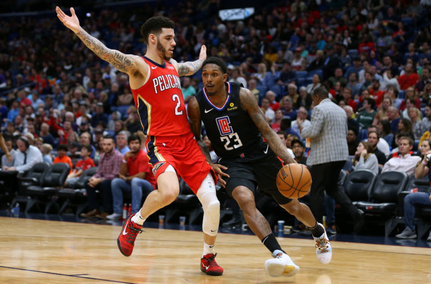 NEW ORLEANS, LOUISIANA - JANUARY 18: Lou Williams #23 of the LA Clippers drives against Lonzo Ball #2 of the New Orleans Pelicans during a game at the Smoothie King Center on January 18, 2020 in New Orleans, Louisiana. NOTE TO USER: User expressly acknowledges and agrees that, by downloading and or using this Photograph, user is consenting to the terms and conditions of the Getty Images License Agreement. (Photo by Jonathan Bachman/Getty Images)