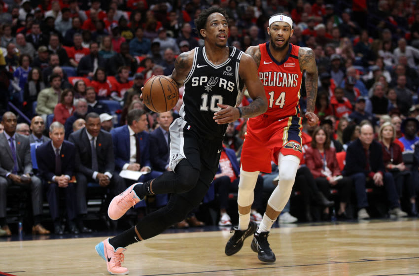 NEW ORLEANS, LOUISIANA - JANUARY 22: DeMar DeRozan #10 of the San Antonio Spurs drives the ball around Brandon Ingram #14 of the New Orleans Pelicans at Smoothie King Center on January 22, 2020 in New Orleans, Louisiana. NOTE TO USER: User expressly acknowledges and agrees that, by downloading and/or using this photograph, user is consenting to the terms and conditions of the Getty Images License Agreement. (Photo by Chris Graythen/Getty Images)