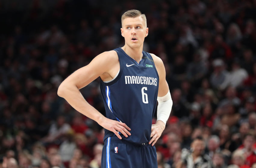 PORTLAND, OREGON - JANUARY 23: Kristaps Porzingis #6 of the Dallas Mavericks reacts in the fourth quarter against the Portland Trail Blazers during their game at Moda Center on January 23, 2020 in Portland, Oregon. NOTE TO USER: User expressly acknowledges and agrees that, by downloading and or using this photograph, User is consenting to the terms and conditions of the Getty Images License Agreement (Photo by Abbie Parr/Getty Images)