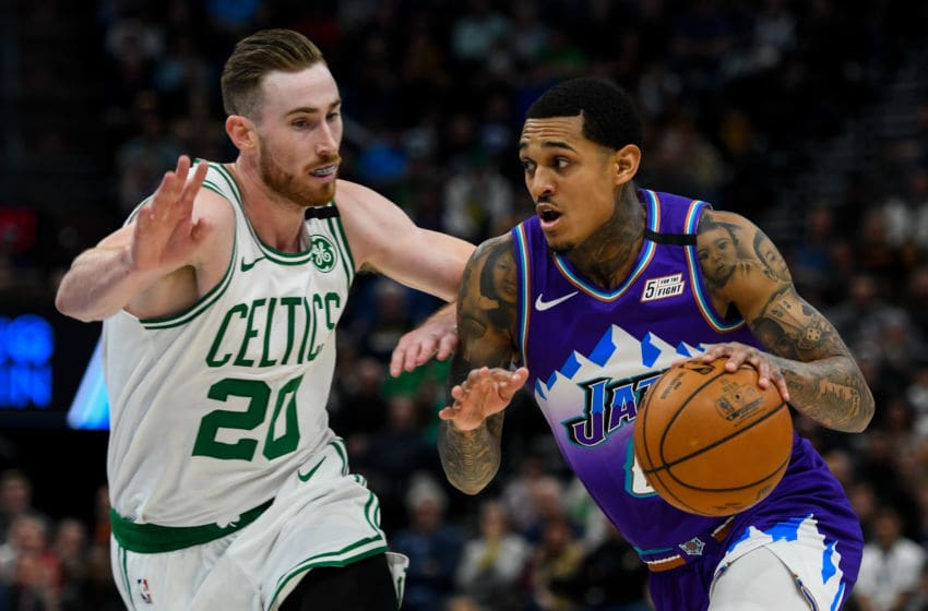 SALT LAKE CITY, UT - FEBRUARY 26: Jordan Clarkson #00 of the Utah Jazz drives past Gordon Hayward #20 of the Boston Celtics during a game at Vivint Smart Home Arena on February 26, 2020 in Salt Lake City, Utah. NOTE TO USER: User expressly acknowledges and agrees that, by downloading and/or using this photograph, user is consenting to the terms and conditions of the Getty Images License Agreement. (Photo by Alex Goodlett/Getty Images)