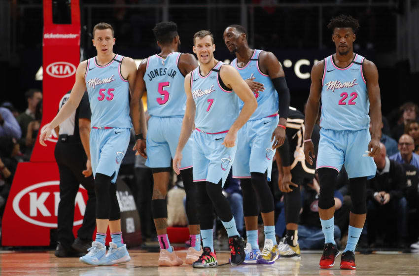 ATLANTA, GA - FEBRUARY 20: Duncan Robinson #55, Derrick Jones Jr. #5, Goran Dragic #7, Bam Adebayo #13, and Jimmy Butler #22 of the Miami Heat make their way back to the bench during a break in play during the second half of an NBA game against the Atlanta Hawks at State Farm Arena on February 20, 2020 in Atlanta, Georgia. NOTE TO USER: User expressly acknowledges and agrees that, by downloading and/or using this photograph, user is consenting to the terms and conditions of the Getty Images License Agreement. (Photo by Todd Kirkland/Getty Images)