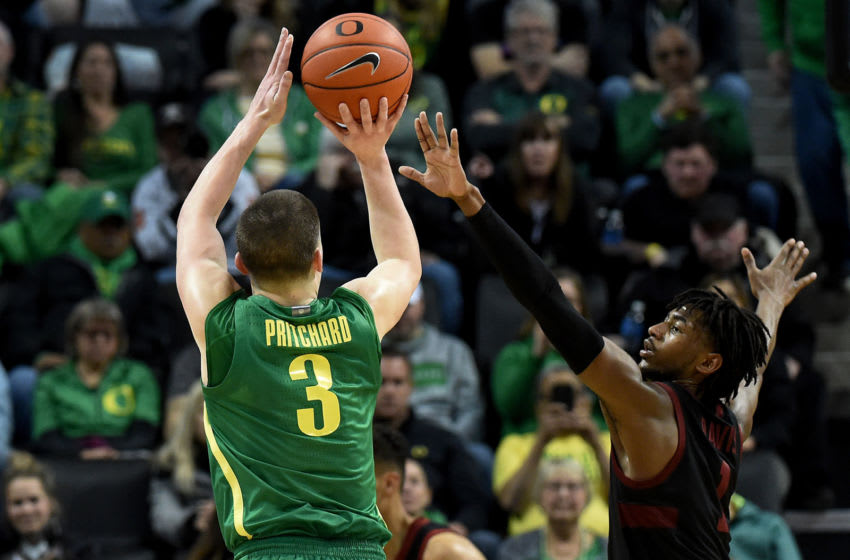 EUGENE, OREGON - MARCH 07: Payton Pritchard #3 of the Oregon Ducks hits a shot over Daejon Davis #1 of the Stanford Cardinal during the second half at Matthew Knight Arena on March 07, 2020 in Eugene, Oregon. Oregon won 80-67. (Photo by Steve Dykes/Getty Images)