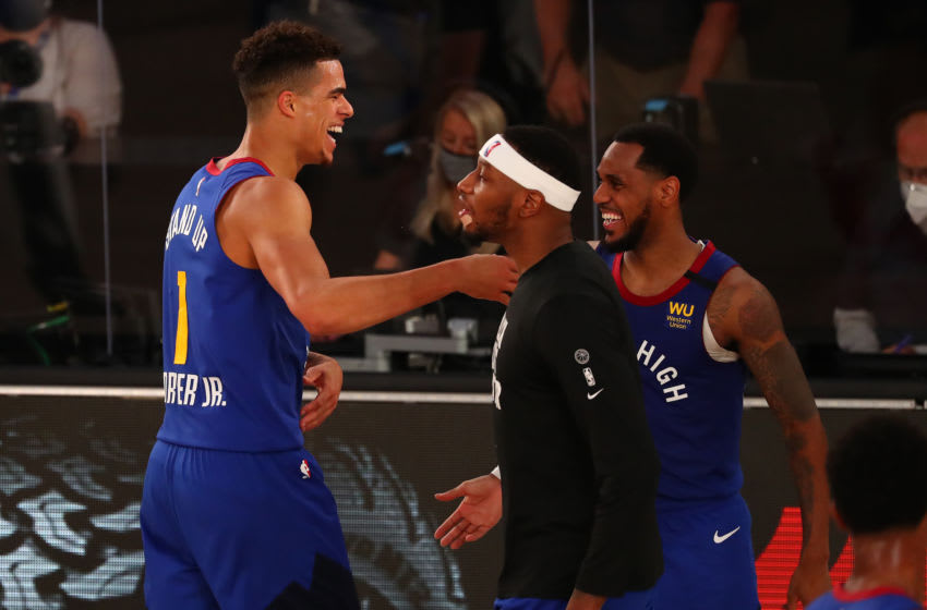LAKE BUENA VISTA, FLORIDA - AUGUST 05: Michael Porter Jr. #1 of the Denver Nuggets celebrates with teammates during action against the San Antonio Spurs in the second half at Visa Athletic Center at ESPN Wide World Of Sports Complex on August 5, 2020 in Lake Buena Vista, Florida. NOTE TO USER: User expressly acknowledges and agrees that, by downloading and or using this photograph, User is consenting to the terms and conditions of the Getty Images License Agreement. (Photo by Kim Klement-Pool/Getty Images)
