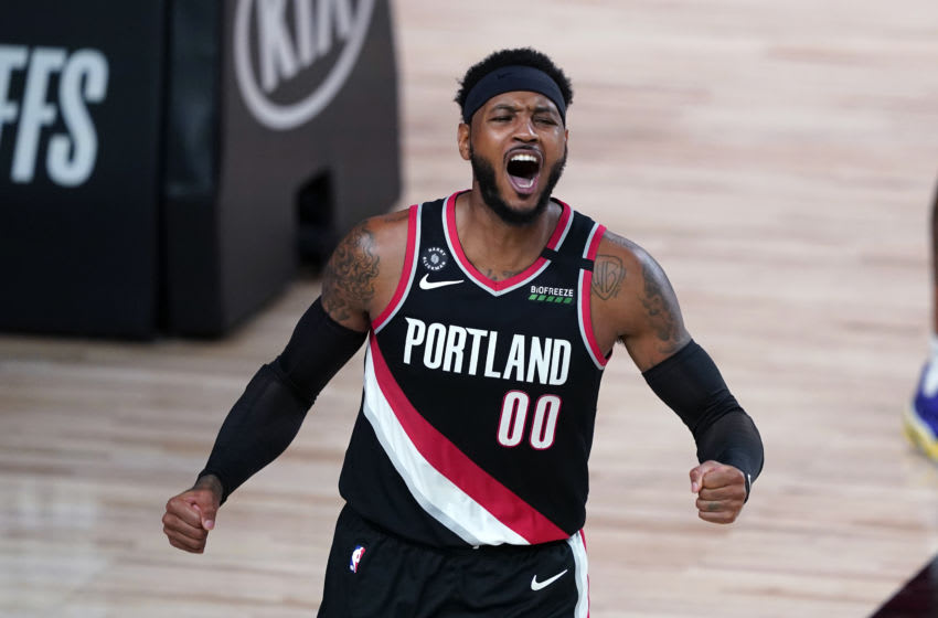 LAKE BUENA VISTA, FLORIDA - AUGUST 18: Carmelo Anthony #00 of the Portland Trail Blazers reacts during the first half against the Los Angeles Lakers in Game 1 of Round 1 of the NBA Playoffs at AdventHealth Arena at ESPN Wide World Of Sports Complex on August 18, 2020 in Lake Buena Vista, Florida. NOTE TO USER: User expressly acknowledges and agrees that, by downloading and or using this photograph, User is consenting to the terms and conditions of the Getty Images License Agreement. (Photo by Ashley Landis-Pool/Getty Images)