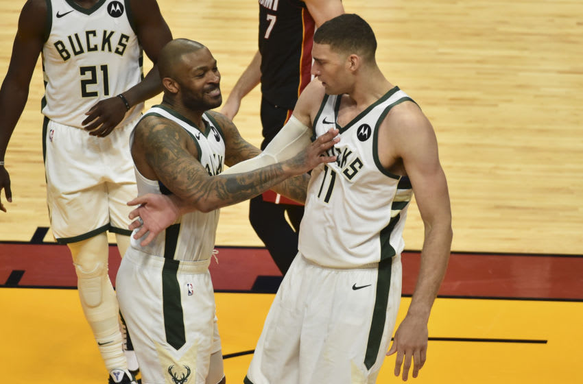 MIAMI, FL - MAY 29: P.J. Tucker #17 of the Milwaukee Bucks celebrates with Brook Lopez #11 during the fourth quarter against the Miami Heat in Game Four of the Eastern Conference first-round playoff series at American Airlines Arena on May 29, 2021 in Miami, Florida. (NOTE TO USER: User expressly acknowledges and agrees that, by downloading and or using this photograph, User is consenting to the terms and conditions of the Getty Images License Agreement.(Photo by Eric Espada/Getty Images)