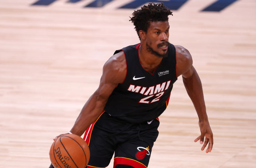 LAKE BUENA VISTA, FLORIDA - AUGUST 18: Jimmy Butler #22 of the Miami Heat dribbles the ball during the second quarter against the Indiana Pacers in Game One of the Eastern Conference First Round during the 2020 NBA Playoffs at AdventHealth Arena at ESPN Wide World Of Sports Complex on August 18, 2020 in Lake Buena Vista, Florida. NOTE TO USER: User expressly acknowledges and agrees that, by downloading and or using this photograph, User is consenting to the terms and conditions of the Getty Images License Agreement. (Photo by Mike Ehrmann/Getty Images)