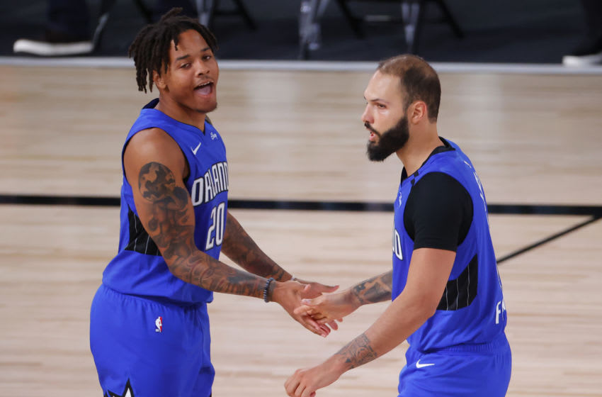 LAKE BUENA VISTA, FLORIDA - AUGUST 29: Evan Fournier #10 celebrates with Markelle Fultz #20 of the Orlando Magic after shooting a three point basket against the Milwaukee Bucks during the fourth quarter in Game Five of the Eastern Conference First Round during the 2020 NBA Playoffs at AdventHealth Arena at ESPN Wide World Of Sports Complex on August 29, 2020 in Lake Buena Vista, Florida. NOTE TO USER: User expressly acknowledges and agrees that, by downloading and or using this photograph, User is consenting to the terms and conditions of the Getty Images License Agreement. (Photo by Kevin C. Cox/Getty Images)