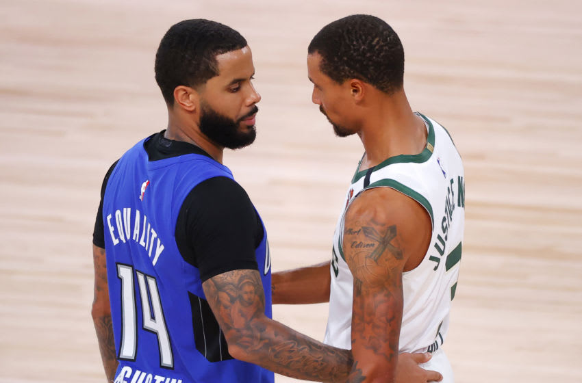 LAKE BUENA VISTA, FLORIDA - AUGUST 29: D.J. Augustin #14 of the Orlando Magic and George Hill #3 of the Milwaukee Bucks hug following Game Five of the Eastern Conference First Round during the 2020 NBA Playoffs at AdventHealth Arena at ESPN Wide World Of Sports Complex on August 29, 2020 in Lake Buena Vista, Florida. NOTE TO USER: User expressly acknowledges and agrees that, by downloading and or using this photograph, User is consenting to the terms and conditions of the Getty Images License Agreement. (Photo by Kevin C. Cox/Getty Images)