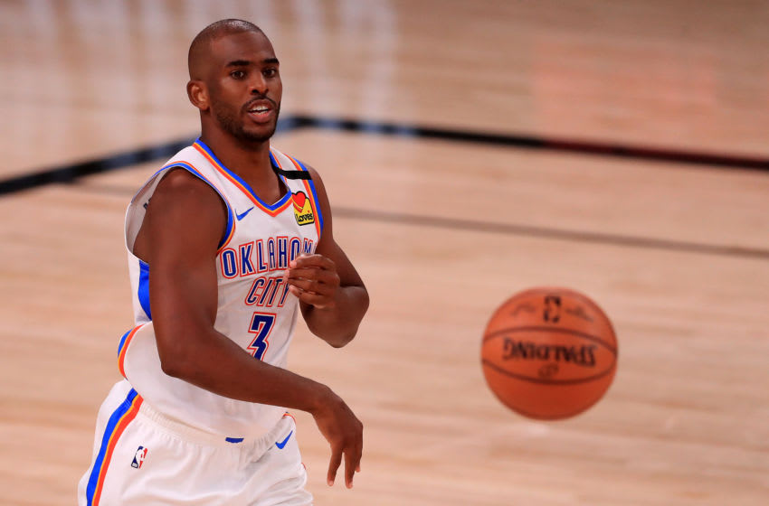 LAKE BUENA VISTA, FLORIDA - SEPTEMBER 02: Chris Paul #3 of the Oklahoma City Thunder passes the ball during the second quarter against the Houston Rockets in Game Seven of the Western Conference First Round during the 2020 NBA Playoffs at AdventHealth Arena at ESPN Wide World Of Sports Complex on September 02, 2020 in Lake Buena Vista, Florida. NOTE TO USER: User expressly acknowledges and agrees that, by downloading and or using this photograph, User is consenting to the terms and conditions of the Getty Images License Agreement. (Photo by Mike Ehrmann/Getty Images)