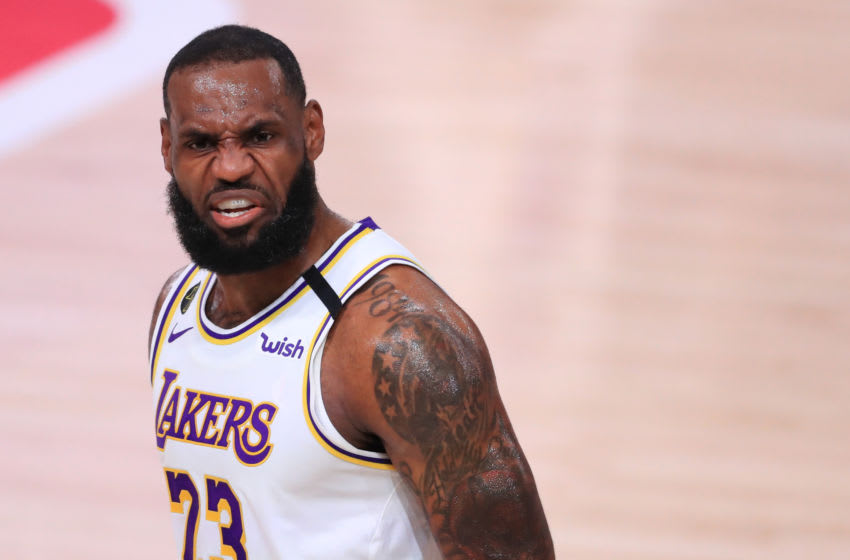 LAKE BUENA VISTA, FLORIDA - SEPTEMBER 12: LeBron James #23 of the Los Angeles Lakers reacts during the first quarter against the Houston Rockets in Game Five of the Western Conference Second Round during the 2020 NBA Playoffs at AdventHealth Arena at the ESPN Wide World Of Sports Complex on September 12, 2020 in Lake Buena Vista, Florida. NOTE TO USER: User expressly acknowledges and agrees that, by downloading and or using this photograph, User is consenting to the terms and conditions of the Getty Images License Agreement. (Photo by Michael Reaves/Getty Images)