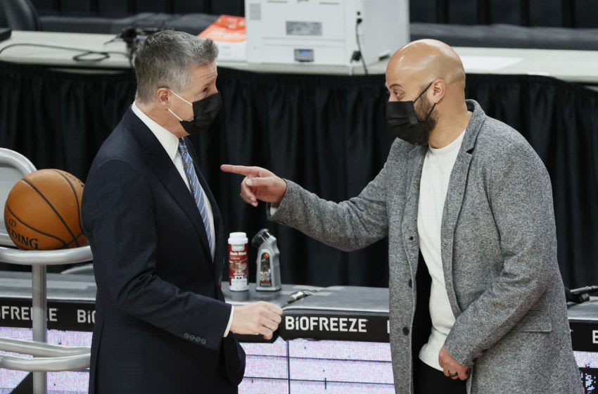 PORTLAND, OREGON - DECEMBER 26: General Manager Neil Olshey of the Portland Trail Blazers speaks with General Manager Rafael Stone of the Houston Rockets during warm ups before the game against the Houston Rockets at Moda Center on December 26, 2020 in Portland, Oregon. NOTE TO USER: User expressly acknowledges and agrees that, by downloading and/or using this photograph, user is consenting to the terms and conditions of the Getty Images License Agreement. (Photo by Steph Chambers/Getty Images)