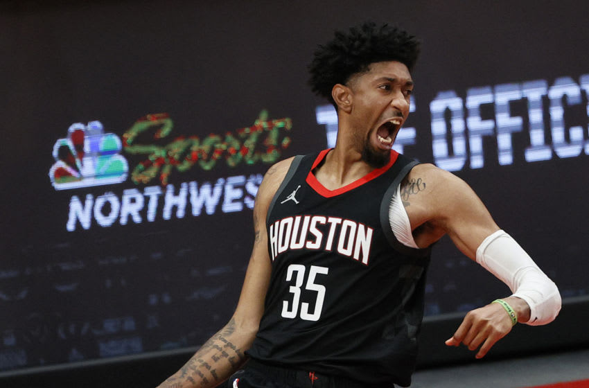 PORTLAND, OREGON - DECEMBER 26: Christian Wood #35 of the Houston Rockets reacts after his dunk against the Portland Trail Blazers during the second quarter at Moda Center on December 26, 2020 in Portland, Oregon. NOTE TO USER: User expressly acknowledges and agrees that, by downloading and/or using this photograph, user is consenting to the terms and conditions of the Getty Images License Agreement. (Photo by Steph Chambers/Getty Images)