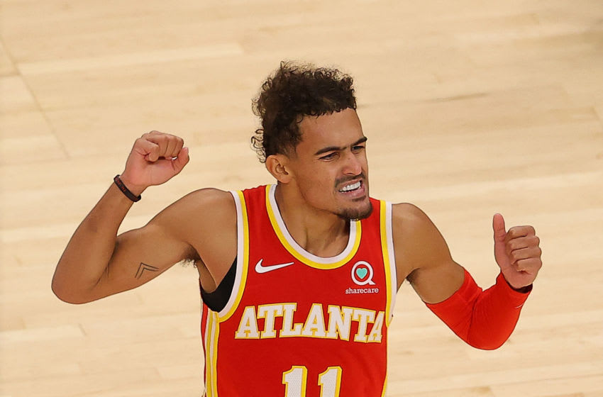 ATLANTA, GEORGIA - DECEMBER 28: Trae Young #11 of the Atlanta Hawks reacts during the first half against the Detroit Pistons at State Farm Arena on December 28, 2020 in Atlanta, Georgia. NOTE TO USER: User expressly acknowledges and agrees that, by downloading and or using this photograph, User is consenting to the terms and conditions of the Getty Images License Agreement. (Photo by Kevin C. Cox/Getty Images)