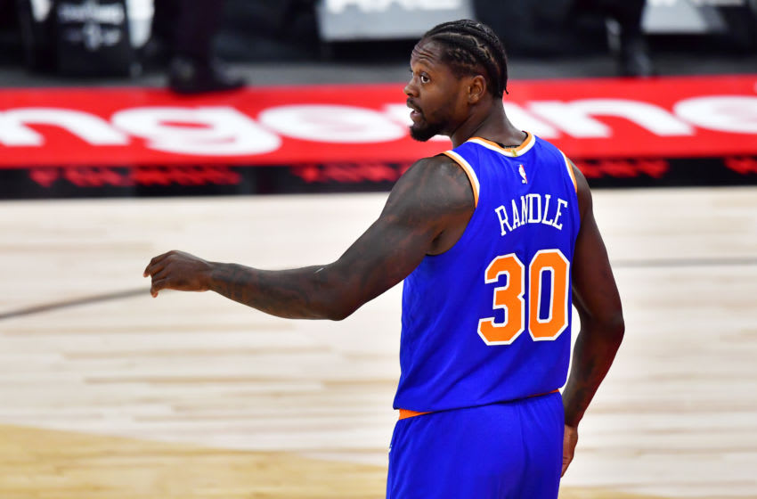 TAMPA, FLORIDA - DECEMBER 31: Julius Randle #30 of the New York Knicks looks on during the first half against the Toronto Raptors at Amalie Arena on December 31, 2020 in Tampa, Florida. NOTE TO USER: User expressly acknowledges and agrees that, by downloading and or using this photograph, User is consenting to the terms and conditions of the Getty Images License Agreement. (Photo by Julio Aguilar/Getty Images)