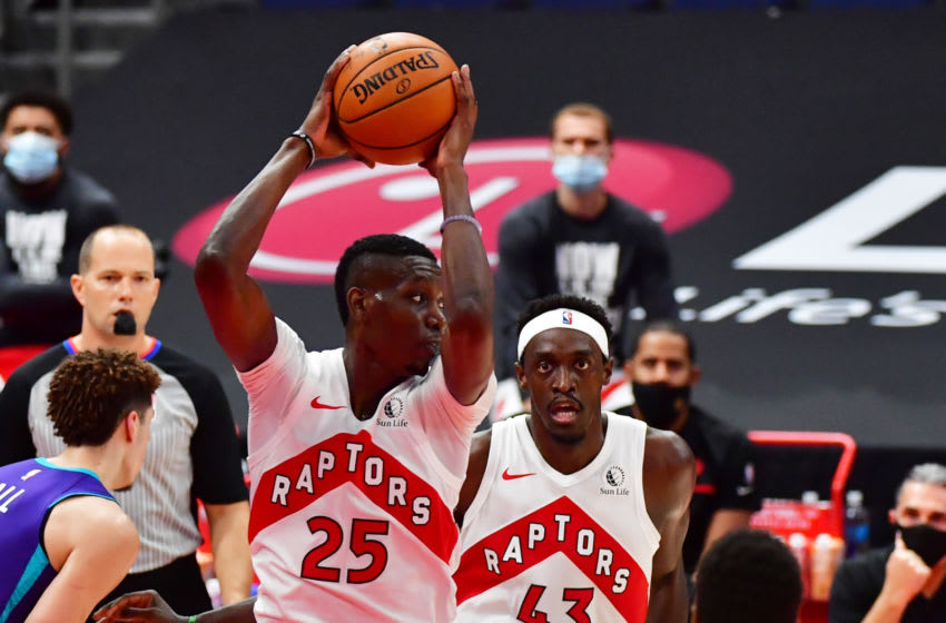 TAMPA, FLORIDA - JANUARY 14: Chris Boucher #25 of the Toronto Raptors grabs a defensive rebound during the second half against the Charlotte Hornets at Amalie Arena on January 14, 2021 in Tampa, Florida. NOTE TO USER: User expressly acknowledges and agrees that, by downloading and or using this photograph, User is consenting to the terms and conditions of the Getty Images License Agreement. (Photo by Julio Aguilar/Getty Images)