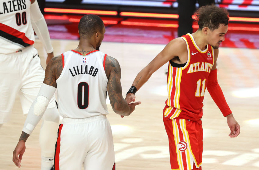 PORTLAND, OREGON - JANUARY 16: Damian Lillard #0 of the Portland Trail Blazers and Trae Young #11 of the Atlanta Hawks shake hands after the Blazers defeated the Hawks 112-106 at Moda Center on January 16, 2021 in Portland, Oregon. NOTE TO USER: User expressly acknowledges and agrees that, by downloading and or using this photograph, User is consenting to the terms and conditions of the Getty Images License Agreement. (Photo by Abbie Parr/Getty Images)