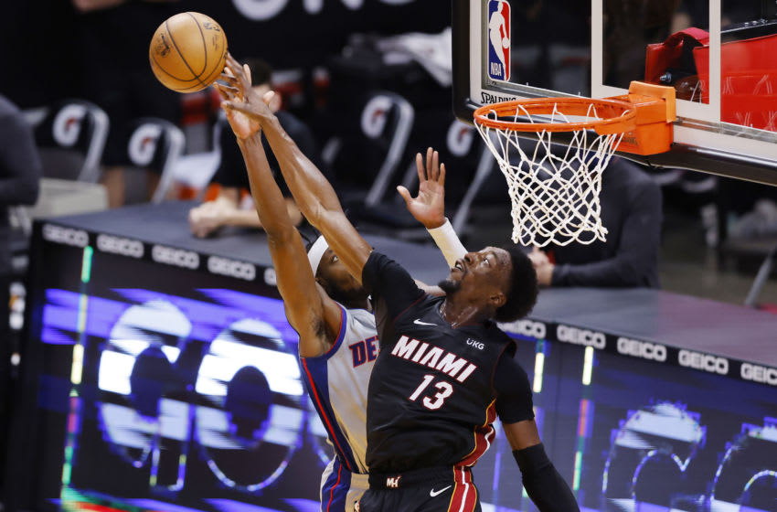 MIAMI, FLORIDA - JANUARY 18: Bam Adebayo #13 of the Miami Heat blocks a shot by Jerami Grant #9 of the Detroit Pistons during the fourth quarter at American Airlines Arena on January 18, 2021 in Miami, Florida. NOTE TO USER: User expressly acknowledges and agrees that, by downloading and or using this photograph, User is consenting to the terms and conditions of the Getty Images License Agreement. (Photo by Michael Reaves/Getty Images)