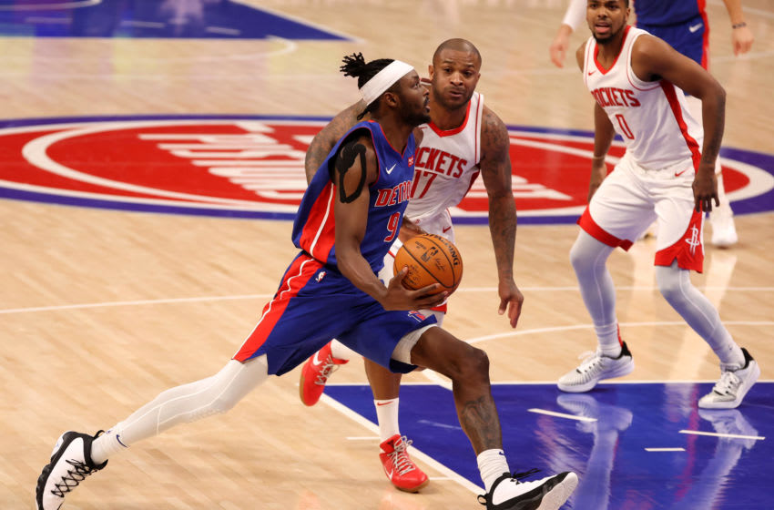 DETROIT, MICHIGAN - JANUARY 22: Jerami Grant #9 of the Detroit Pistons drives to the basket past P.J. Tucker #17 of the Houston Rockets during the final seconds of the second half at Little Caesars Arena on January 22, 2021 in Detroit, Michigan. NOTE TO USER: User expressly acknowledges and agrees that, by downloading and or using this photograph, User is consenting to the terms and conditions of the Getty Images License Agreement. (Photo by Gregory Shamus/Getty Images)