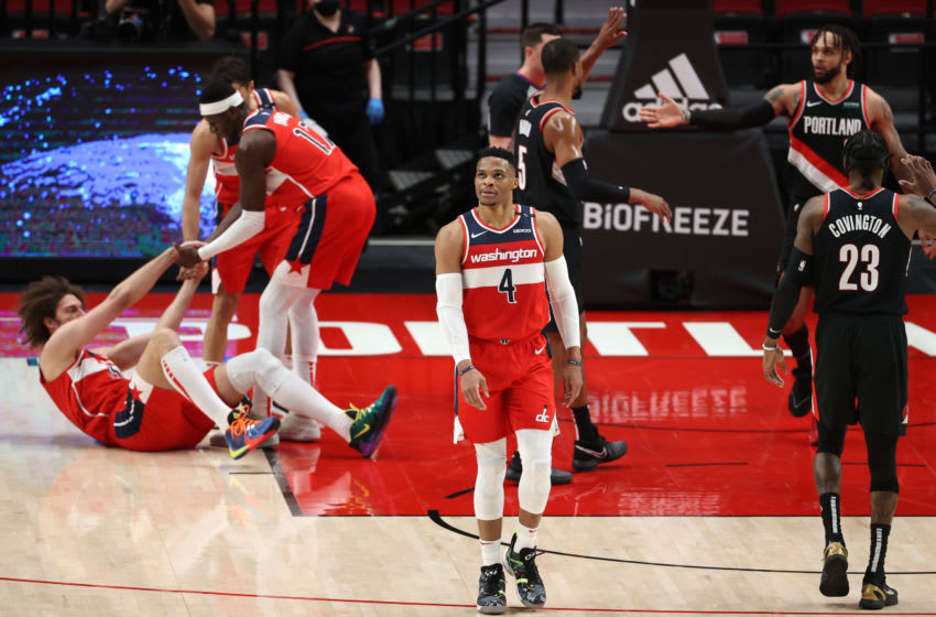 PORTLAND, OREGON - FEBRUARY 20: Russell Westbrook #4 of the Washington Wizards reacts in the second quarter against the Portland Trail Blazers at Moda Center on February 20, 2021 in Portland, Oregon. NOTE TO USER: User expressly acknowledges and agrees that, by downloading and or using this photograph, User is consenting to the terms and conditions of the Getty Images License Agreement. (Photo by Abbie Parr/Getty Images)