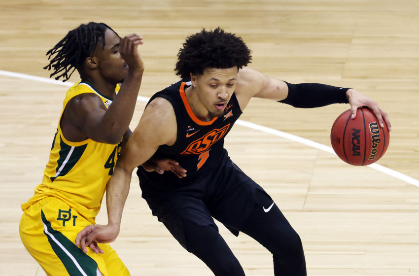 KANSAS CITY, MISSOURI - MARCH 12: Cade Cunningham #2 of the Oklahoma State Cowboys controls the ball as Davion Mitchell #45 of the Baylor Bears defends during the Big 12 basketball tournament semifinal game at the T-Mobile Center on March 12, 2021 in Kansas City, Missouri. (Photo by Jamie Squire/Getty Images)