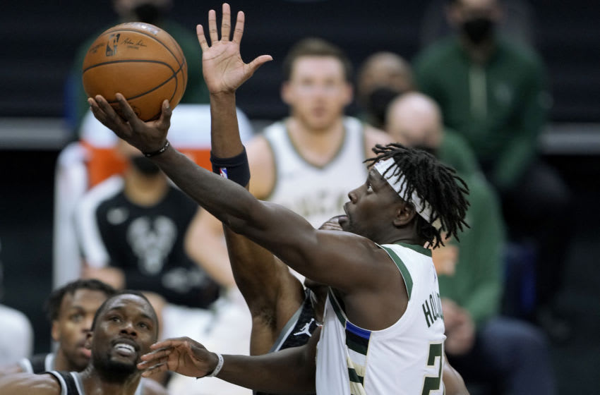 SACRAMENTO, CALIFORNIA - APRIL 03: Jrue Holiday #21 of the Milwaukee Bucks shoots against De'Aaron Fox #5 of the Sacramento Kings during the second half of an NBA basketball game at Golden 1 Center on April 03, 2021 in Sacramento, California. NOTE TO USER: User expressly acknowledges and agrees that, by downloading and or using this photograph, User is consenting to the terms and conditions of the Getty Images License Agreement. (Photo by Thearon W. Henderson/Getty Images)