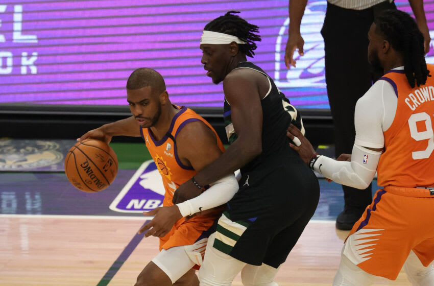 MILWAUKEE, WISCONSIN - JULY 20: Chris Paul #3 of the Phoenix Suns drives around Jrue Holiday #21 of the Milwaukee Bucks during the first quarter in Game Six of the NBA Finals at Fiserv Forum on July 20, 2021 in Milwaukee, Wisconsin. NOTE TO USER: User expressly acknowledges and agrees that, by downloading and or using this photograph, User is consenting to the terms and conditions of the Getty Images License Agreement. (Photo by Jonathan Daniel/Getty Images)