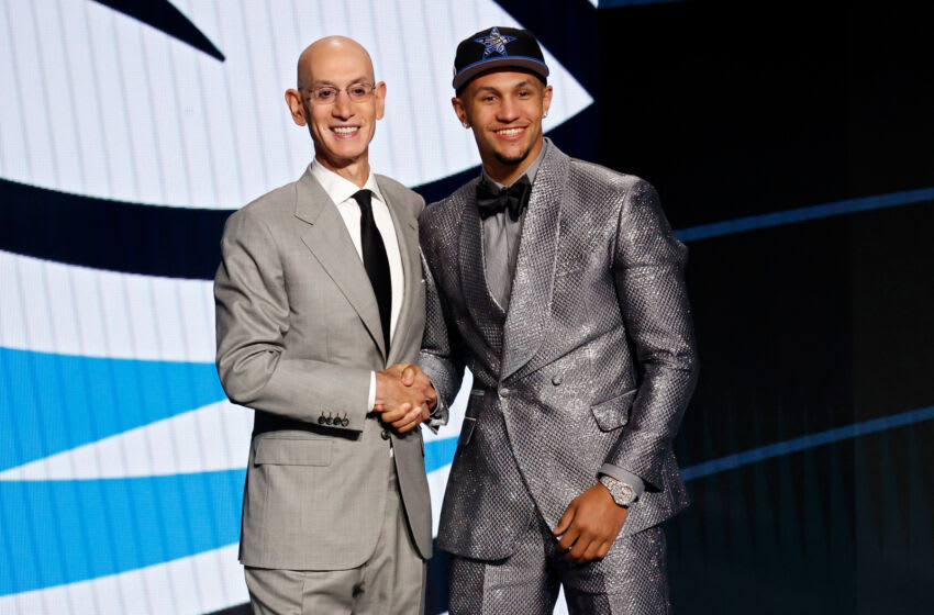 NEW YORK, NEW YORK - JULY 29: NBA commissioner Adam Silver (L) and Jalen Suggs pose for photos after Suggs was drafted by the Orlando Magic during the 2021 NBA Draft at the Barclays Center on July 29, 2021 in New York City. (Photo by Arturo Holmes/Getty Images)