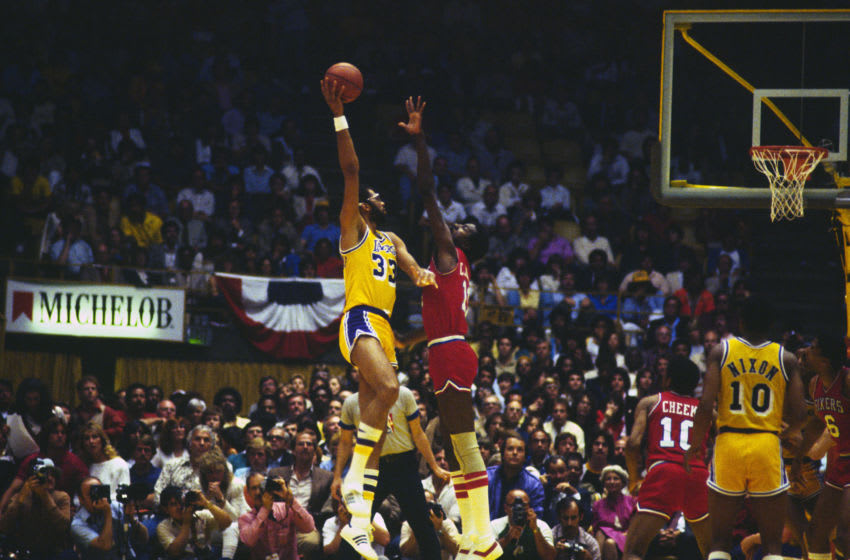 INGLEWOOD, CA - JUNE 1982: Kareem Abdul-Jabbar #33 of the Los Angeles Lakers shoots over Caldwell Jones #11 of the Philadelphia 76ers during the 1982 NBA basketball Finals at The Forum in Inglewood, California. The lakers won the Championship 4 games to 2. (Photo by Focus on Sport/Getty Images)