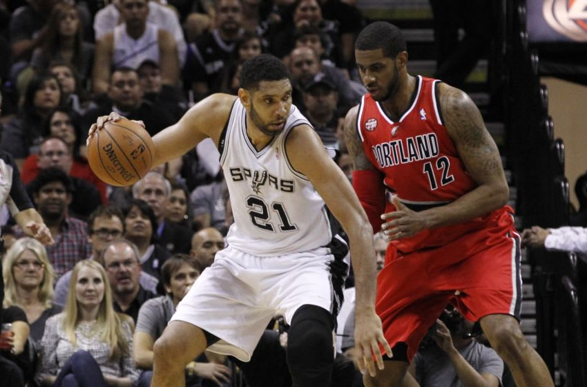SAN ANTONIO, TX - MAY 14: Tim Duncan #21 of the San Antonio Spurs moves with the ball against LaMarcus Aldridge #12 of the Portland Trail Blazers in Game Five of the Western Conference Semifinals during the 2014 NBA Playoffs at the AT&T Center on May 14, 2014 in San Antonio, Texas. NOTE TO USER: User expressly acknowledges and agrees that, by downloading and/or using this photograph, user is consenting to the terms and conditions of the Getty Images License Agreement. (Photo by Chris Covatta/Getty Images)
