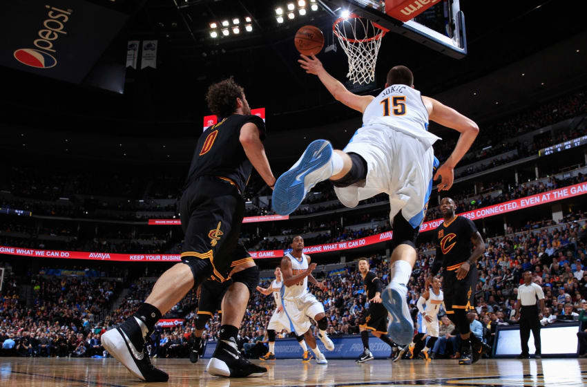 DENVER, CO - DECEMBER 29: Nikola Jokic #15 of the Denver Nuggets lays up a shot against Kevin Love #0 of the Cleveland Cavaliers at Pepsi Center on December 29, 2015 in Denver, Colorado. The Cavaliers defeated the Nuggets 93-87. NOTE TO USER: User expressly acknowledges and agrees that, by downloading and or using this photograph, User is consenting to the terms and conditions of the Getty Images License Agreement. (Photo by Doug Pensinger/Getty Images)
