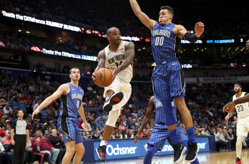 NEW ORLEANS, LA - OCTOBER 30: Jameer Nelson #14 of the New Orleans Pelicans passes the ball around Aaron Gordon #00 of the Orlando Magic at the Smoothie King Center on October 30, 2017 in New Orleans, Louisiana. NOTE TO USER: User expressly acknowledges and agrees that, by downloading and or using this photograph, User is consenting to the terms and conditions of the Getty Images License Agreement. (Photo by Chris Graythen/Getty Images)